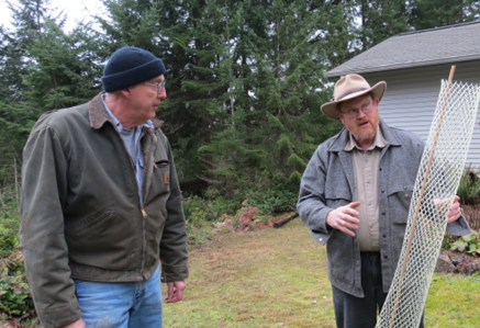 Sam Comstock and Mike Nystrom talk about forest seedlings. Photo: Lelde Vilkriste