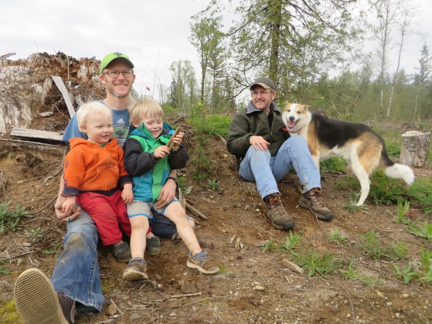 Dave New (right), son-in-law Jeff, and grandsons Alex and Tyler. Photo taken in 2016 as annual event photo taken by the planted Douglas-fir. (Photo by the New family)